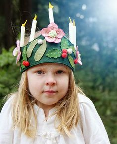 """A FREE pattern to make a lovely felt crown graced with hellebore flowers, mistletoe, and holly with removable """"candles"""" for all of your winter celebrations. Ple"""