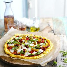This polenta base is very quick to make and gluten free, too. If you like, use veggie-friendly cheeses.