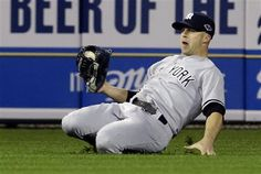 ALCS GAME 3: Tuesday, Oct. 16, 2012 - New York Yankees' Brett Gardner makes a catch on a ball hit by Detroit Tigers' Jhonny Peralta in the eighth inning during Game 3 of the American League championship series in Detroit.