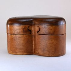 Give your love this handcrafted wooden puzzle box, and let them keep your heart. Perfect as a ring box, trinket box, or just a sweet gift. This wooden box is made by Eka in Bali, a woman who learned h