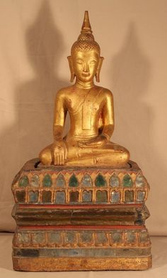 Ayutthaya period seated wood Buddha gilt with mirrors and an inscription on lower edge