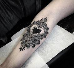 Heart-shaped mandala design by Alex Bawn