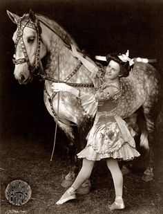 Circus bareback rider and dappled grey Percheron