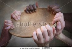 Grunge image of many hands holding an empty bowl