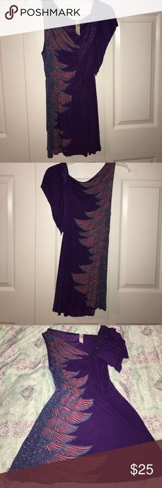 Free People purple gorgeous tunic Excellent used condition Free People tunic. Size small. Deep purple color with asymmetrical neckline beading and blue pink and red pattern. I bought this used but I never wore it Free People Tops Tunics