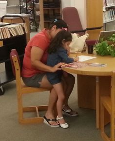 Mom helps Amanda sign up for a Library card.