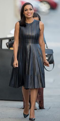 Look of the Day › August 3, 2014 For her appearance on Jimmy Kimmel Live, Rosario Dawson rocked a fiercely edgy and girly look, thanks to her pretty leather Lie Sang Bong dress, pairing it with EF Collection dagger earrings, an EFFY Jewelry ring, and black pumps.