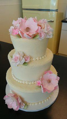 Three-tier Striped Rustic buttercream wedding cake with light pink fondant flowers