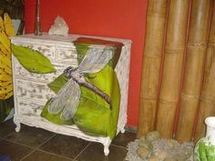 Love this dragonfly painted on a chest of drawers!