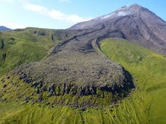 Kanaga Volcano, Aleutian Islands, as seen from the east. The blocky andesite lava flow in the foreground erupted in 1906. Note the confining 'levees.' Photo credit: Michelle Coombs, USGS