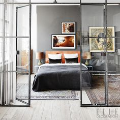 Steel-framed glazing, double doors, bedroom, gray wall, Persian rugs, neutral palette Photography: Sisters Agency