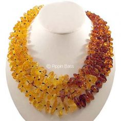 4 strand, 22 inch,  genuine Baltic amber necklace with sterling clasp