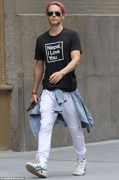 More modest style: Jared Leto took a step back from his eclectic taste in clothes by wearing a simple statement T-shirt and white track trousers while out in NYC on Friday