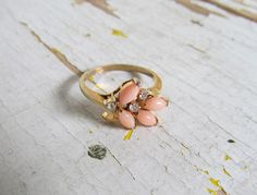 Vintage ring with coral and rhinestones... just plain pretty.