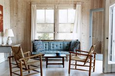 """Alan Wanzenberg, Fire Island, New York  The rustic simplicity of barely finished wood and just a few sticks of clean-lined furniture reign supreme at the Manhattan-based Alan Wanzenberg's own beach house off the southern coast of Long Island, which he bought in the 1980s. As he wrote in his recent book from Pointed Leaf Press, even 25 years later """"the magic and uniqueness of the place still radiates for me."""" Photo by Don Freeman"""