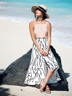 Nicole Warne of Gary Pepper Girl in a spaghetti strap tank tucked into a high-waisted maxi skirt with a wide brim hat