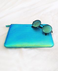 Holographic clutch and sunnies.