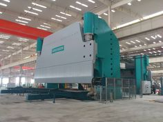 This press brake is a 4,000-ton, 47.5-ft. model that has work supports, front and rear plate positioners, and a gooseneck punch with rollers for quick die change and tooling storage.