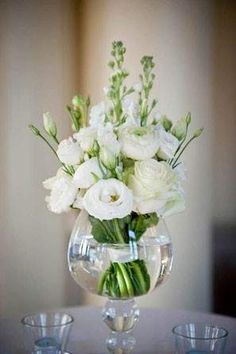 white rose and ranunculus wedding centerpiece