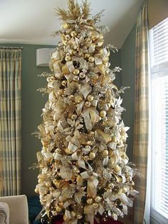 Learn how to decorate a custom Christmas tree.