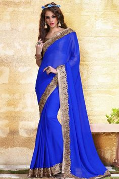 Blue georgette saree with beige silk blouse.  Embellished with embroidered, resham, zari and stone.  Saree comes with round neck blouse.  It is perfect for festival wear, party wear and wedding wear.  Andaaz Fashion is the most popular designer wear online ethnic shop brands.  http://www.andaazfashion.us/womens/sarees/occasion/party-wear-saree