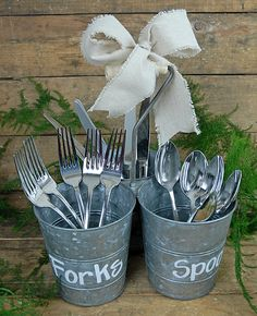 Triple buckets...write forks, spoons, knives with a chalk marker -- great way to house silverware at a laidback party or bbq.