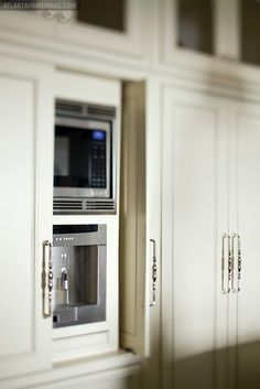 Hidden appliances with pull out and slide back doors