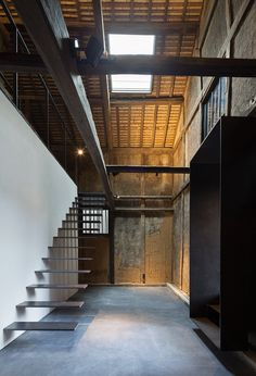 Using the full height of this former mill, architects also created a mezzanine level where visitors can get a closer view of the ageing structure or peer down into its modern addition.