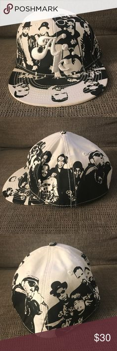 Akomplice Hip-Hop Legends Hat Akomplice Clothing Company  White & Black Fitted Cap 7-3/8  Print running all along the whole hat with some of the most iconic hip hop legends! Classic hat, that I've saved for a long time. Early street wear gem! 💎   Brand New, Never Used 9/10 (super super minor stain on the bottom brim) but overall super clean for all White hat. Akomplice Accessories Hats