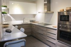 This Farmhouse Modern Kitchen Features Shaker Cabinets In