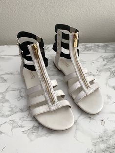 Michael Kors strappy leather flat sandals Gold hardware Exposed zipper and studs Brand name embossed zipper pull Black lasticized straps around ankle Size 6.5 Worn once Excellent condition Sold as is No returns Leather Sandals Flat, Flat Sandals, Gladiator Sandals, Shoes Sandals, Heels, Michael Kors Sandals, Gold Hardware, Studs, Espadrilles