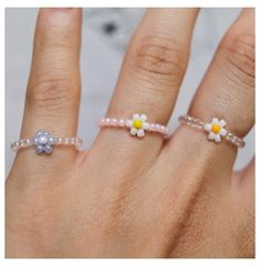 Beaded Daisy Ring, Dainty Flower Ring, Flower Bead Ring, Stackable Ring, Handmade Bead Ring, Minimalistic, Aesthetic Ring #flower #bead #ring #flowerbeadring This super cute dainty daisy ring will be the perfect addition to any outfit! In the photos, I show how they pair with another ring I have available on my Etsy:) The ring is handmade and they're stackable! They mix and match super well with whatever you'd pair them with. I included the 3rd picture so that you can choose the colored… Seed Bead Jewelry, Bead Jewellery, Cute Jewelry, Beaded Jewelry, Jewelery, Jewelry Findings, Jewelry Crafts, Handmade Beads, Handmade Jewelry