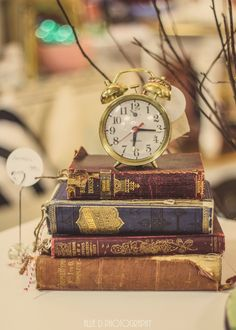 """tattered books stacked with a vintage clock on top. Great way to add interest to shelves. """"Junk Salvation"""" by Funky Junk Sisters: Funky Junk Sisters bring their market to Hillsboro Oregon Feb 6 & 7 Beauty And The Beast Theme, Beauty And Beast Wedding, Wonderland Party, Alice In Wonderland, Vitrine Vintage, Old Clocks, Mad Hatter Tea, Disney Home, Book Aesthetic"""