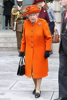 The Queen visited the Royal Academy of Arts in London on Tuesday, 03/21/18. What Queen Elizabeth is wearing today. First Day of Spring. Tangerine Orange coat and hat, black accessories.