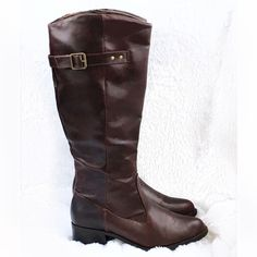 "NWOT  Tall Rampage Idaho Brown Boots  NWOT  Tall Rampage Idaho Brown Boots! New with out tag. Excellent condition. Super comfortable! Faux brown leather. 1.5"" block heel. Inside side zipper. Buckle detail. Falls just above calf. 15"" circumference. 16"" shaft. Wear with thick socks and skinny jeans. Size 8m. Fits 8-8 1/2 Rampage Shoes Combat & Moto Boots"