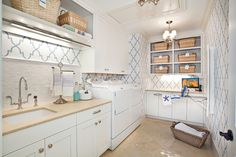 Markay Johnson Construction: Cheerful laundry room with Thibaut Filagree Julian wallpaper Blue on White. White ...