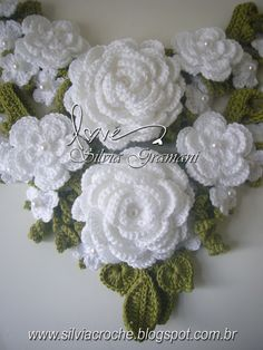 crochet flower neckline--Lovely site. Good for inspiration. Gorgeous Flower Ideas.