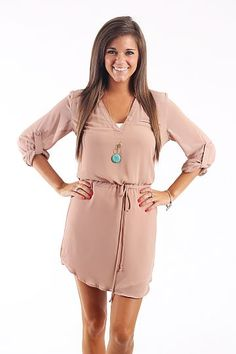 """Golden Era Dress, Taupe $47.00 A dress or a tunic..you choose! The taupe is a staple color to keep in your closet, and looks great with dark denim! :) This one features a drawstring waist and a cute little pocket on the front!   Fits true to size. Miranda is wearing a small.   From shoulder to hem:  Small- 32""""  Medium- 33""""  Large- 34"""""""