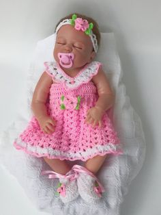 This listing is for a beautiful Crochet baby dress Pattern ROSEBUDS, NOT THE FINISHED ITEM. This Crochet baby pattern includes the patterns for 1. Baby crochet Dress 2 Baby Crochet cardigan/ shrug 2. Crochet headband 3. Crochet shoes/ booties This baby dress pattern will make a