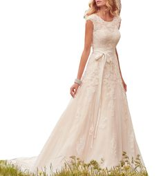"Lava-ring Women's Cap Sleeves Lace Tulle Scoop Illusion Back Long Wedding Dress White US6. Fabric:Tulle;Applique,Bow Sash;Scoop Neck;Sleeveless;Sheer Back;Buttons;Floor-Length;A-line. Detailed size info, please check left image.It is US size when you place order.Do not use Amazon's ""size info"" link. Hand washed in low temperature and laid flat to dry;Ironing on low heat if needed;Storing it with special wedding garment bag. Shipped directly to buyer from Lava-ring Dresses in China. If you..."