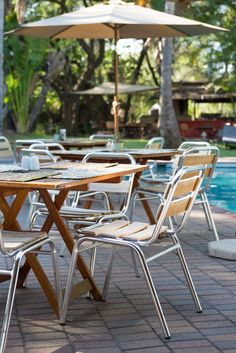 Terrace next to the bar and swimming pool. Swim Up Bar, Thatched Roof, Yummy Snacks, Perfect Place, Terrace, Swimming Pools, Dining Chairs, Furniture, Home Decor