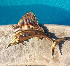 Gorgeous handcrafted copper swordfish metal wall art. Copper with brass details surround edges & nose. Flame painted with torch and clear coated to preserve the color & deter from oxidation. Can be hung inside or out. Large copper hook on back for hanging. In excellent vintage condition! Wonderful gift for anyone who loves game fish or decorates their home in a nautical or beach decor. ⚓️Will ship insured & package carefully. Measures 20.25 length x 15 height x 1.75 depth when hu...