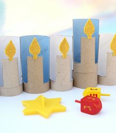 Cardboard Tube Menorah This Hanukkah have the kids put together this cool menorah using recycled cardboard tubes and craft foam. Its a great holiday activity. The post Cardboard Tube Menorah was featured on Fun Family Crafts. Hanukkah Crafts, Hanukkah Decorations, Hanukkah Menorah, Happy Hanukkah, Holiday Crafts, Hannukah, Jewish Crafts, Kwanzaa, Kids Crafts