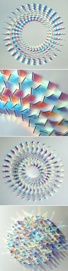 "These are glass wall panel installations by UK based artist Chris Wood. She says that her work is about expressing the ""magic of light"".  She uses dichroic glass"