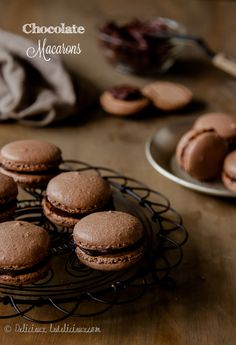 Chocolate #macarons with dark chocolate ganache filling | via ledelicieux.com