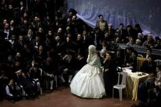 The men and women are separated by a veil during the ceremony as the bride must be fully covered when she enters the men's section of the ceremony.