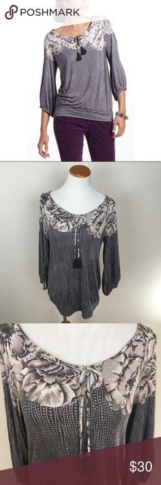 DELETTA Anthro Margherita Tassel Floral Blouse DELETTA Anthropologie Margherita Tassel Gray Floral Peasant Blouse Small. Excellent condition! Flowy. Clean and comes from smoke free home. Questions welcomed. Anthropologie Tops Blouses