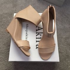 BRAND NEW AKIRA NUDE WEDGE HEELS NEVER WORN & IN ORIGINAL BOX!! Nude wedge heels that wrap around the ankle and have a gold zipper in the back!! AKIRA Shoes Wedges