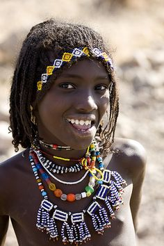 Afar girl with sharpened teeth smiling, Danakil, Ethiopia. Afar people are closely related to Oromo (khemetic/Cushitic people). Black Is Beautiful, Beautiful Smile, Beautiful Children, Beautiful World, Beautiful People, Costume Ethnique, Eric Lafforgue, African Tribes, African Countries