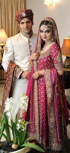 Pakistani wedding. wish his turban was pink to match her :)